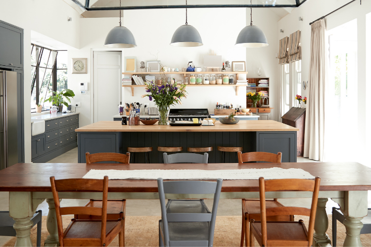 Renovated kitchen with grey cabinets and grey lights