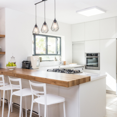 White Kitchen Renovation with Timber benchtops and black lights